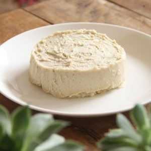 A round of homemade nut cheese on a plate