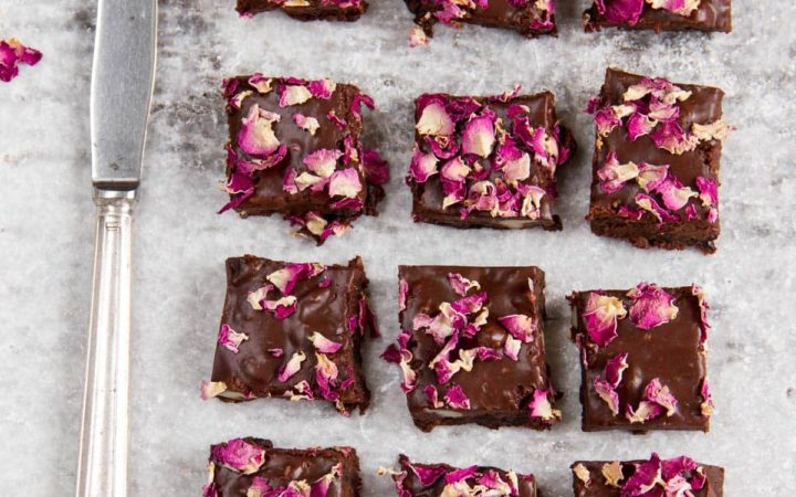 Slices of homemade rocky road decorated with rose petals