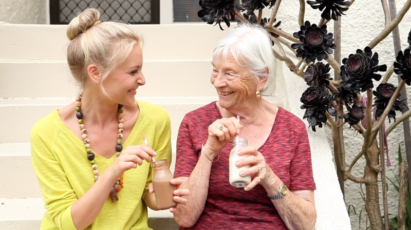Lauren and her Nan enjoying little bottles of homemade cashew milk