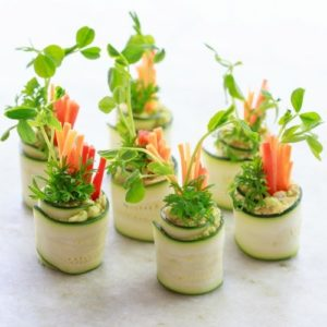 Zucchini strips filled with nut cheese and vegetables rolled into canapes