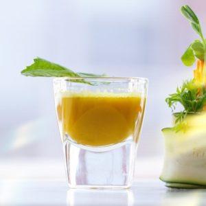Shot glass full of turmeric juice