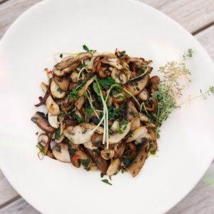 Close up of a freshly cooked mushroom dish on a plate ready to serve