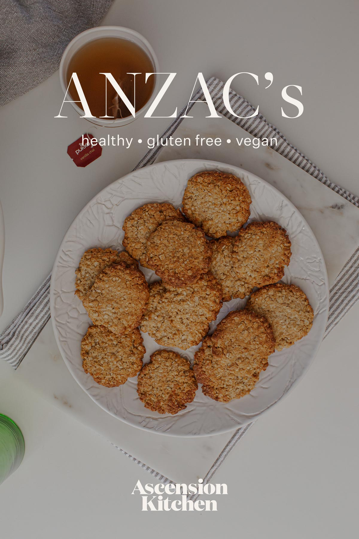Healthy ANZAC Biscuits on a plate on the kitchen bench with hot mug of chai ready to be enjoyed