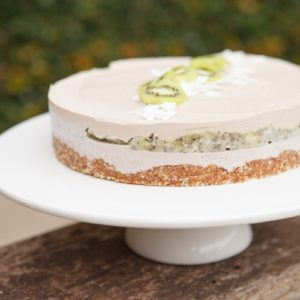 Raw cake on a cake stand on an outdoor table