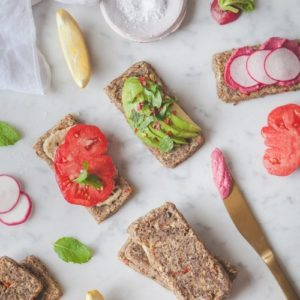 Raw onion bread on a marble counter topped with various spreads