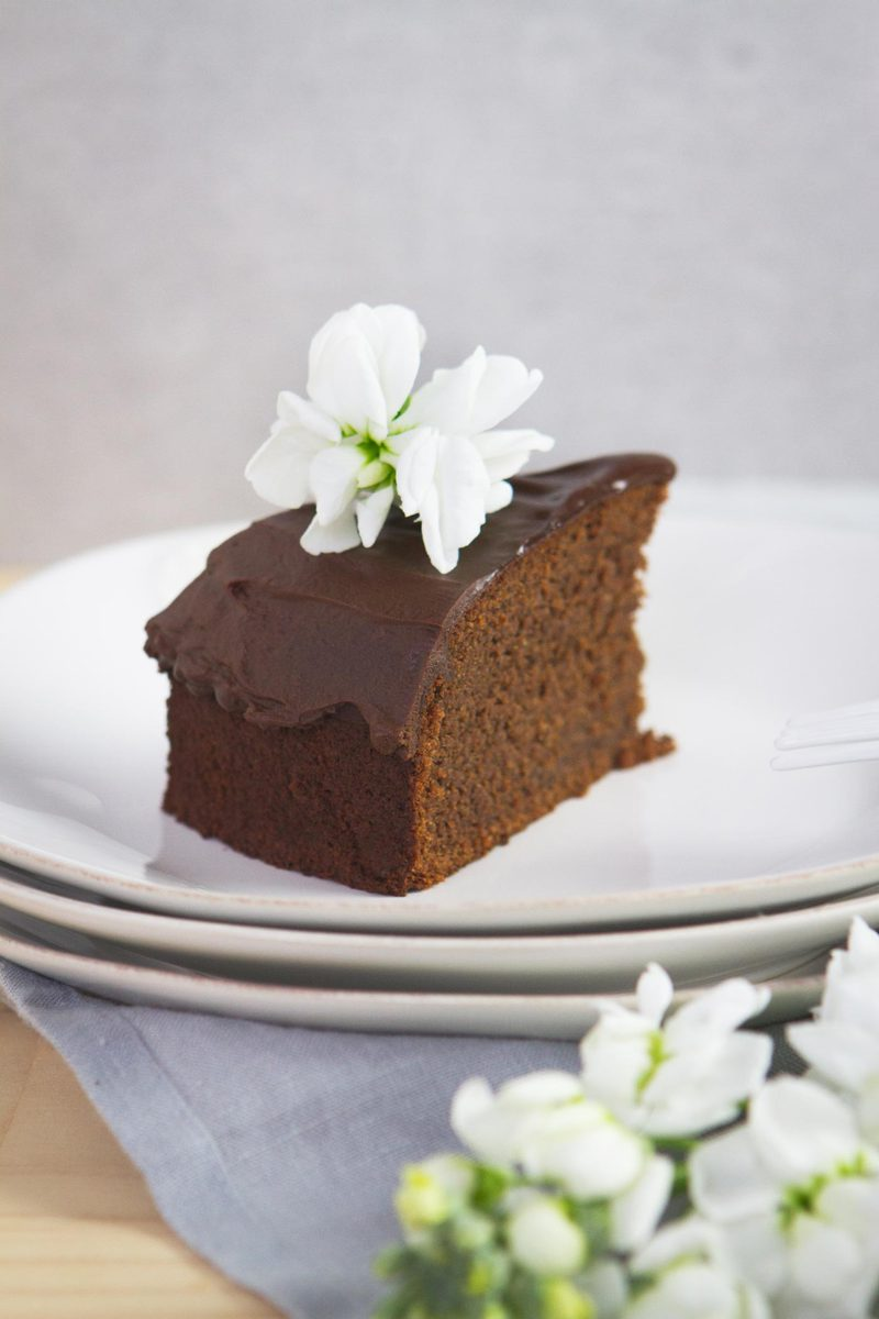 A slice of gluten free vegan chocolate cake on a plate