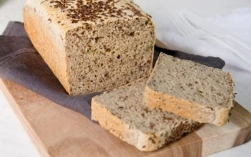 Home baked gluten free bread that has been sliced on the counter