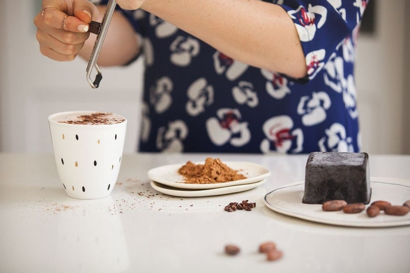 Benefits of Cacao: Lauren grating chocolate over a hot cacao