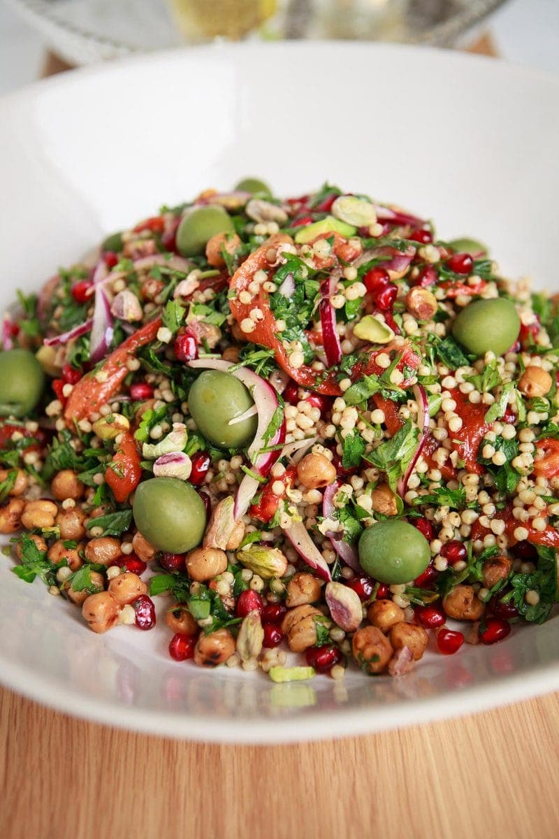 Close up of bright coloured sorghum salad with chickpeas for extra protein