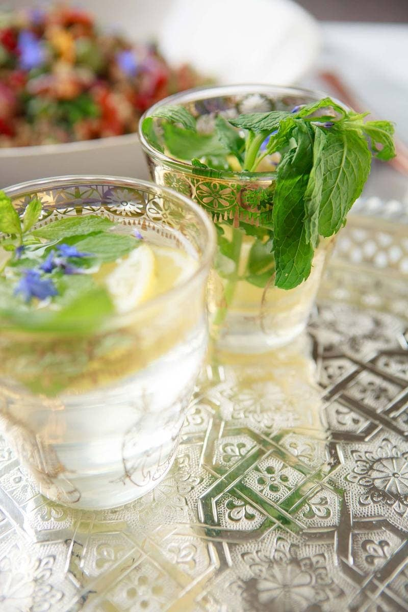 Close up of two Moroccan tea glassed filled with lemon and mint