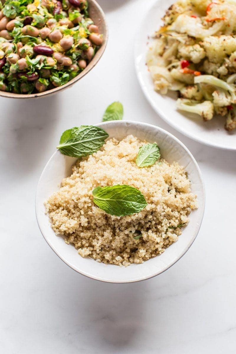 Bowl of fluffy cooked quinoa on the dinner table