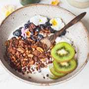 Close up of granola in bowl made with nuts, seeds and cacao and without grains