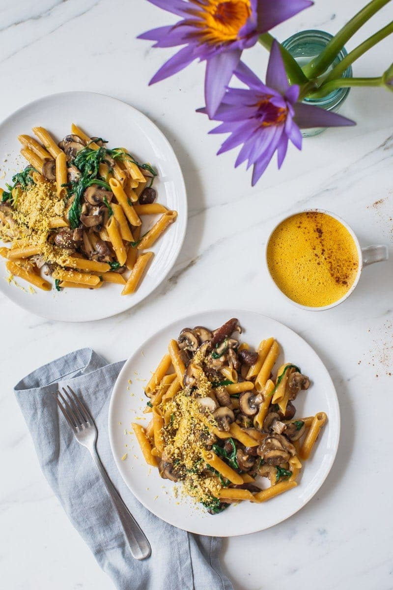 Two plates of creamy mushroom pasta ready to eat