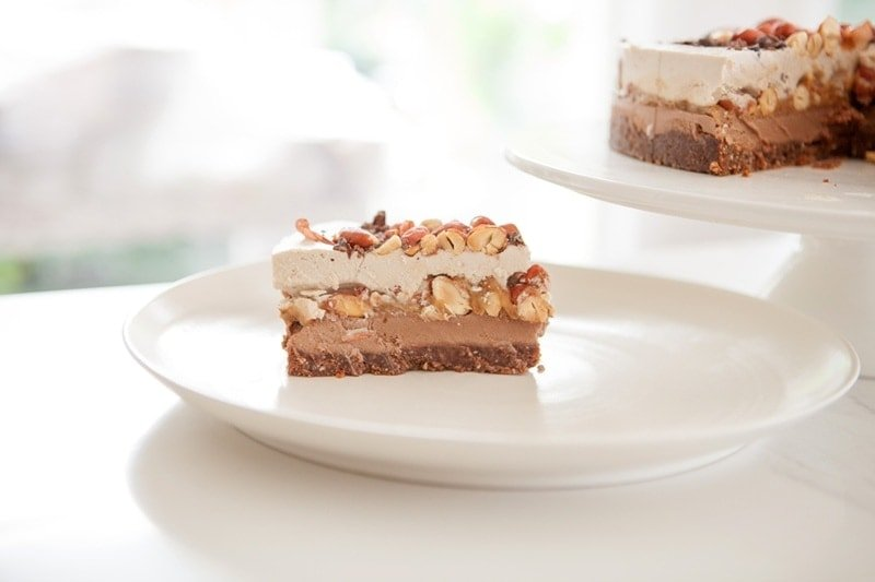 Slice of Snickers Cake on a white plate