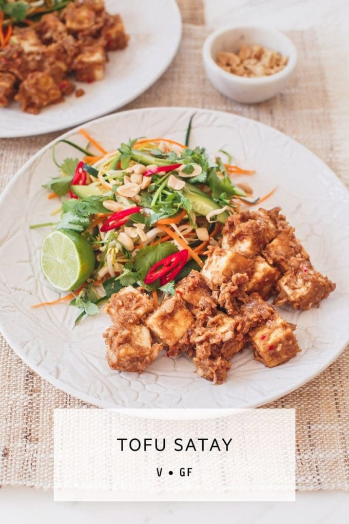 Vegan Tofu Satay – tofu cubes in a spicy peanut satay sauce paired with a crisp raw salad. Healthy and indulgent! ⠀⠀⠀ #vegantofusatay #tofusataycurry #tofusatayhealthy #vegansataysauce #vegansatayrecipe #vegansataytofu #vegansatayglutenfree #AscensionKitchen ⠀⠀⠀ // Pin to your own inspiration board! //