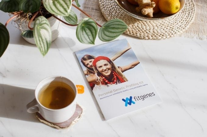 FitGenes genetic profiling kit on a coffee table with a cup of tea