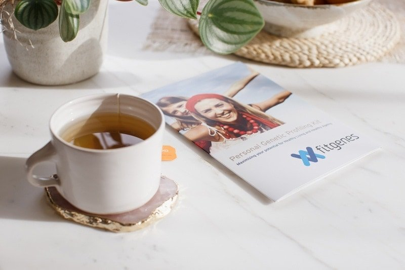 Genetic testing brochure on the kitchen table with cup of tea