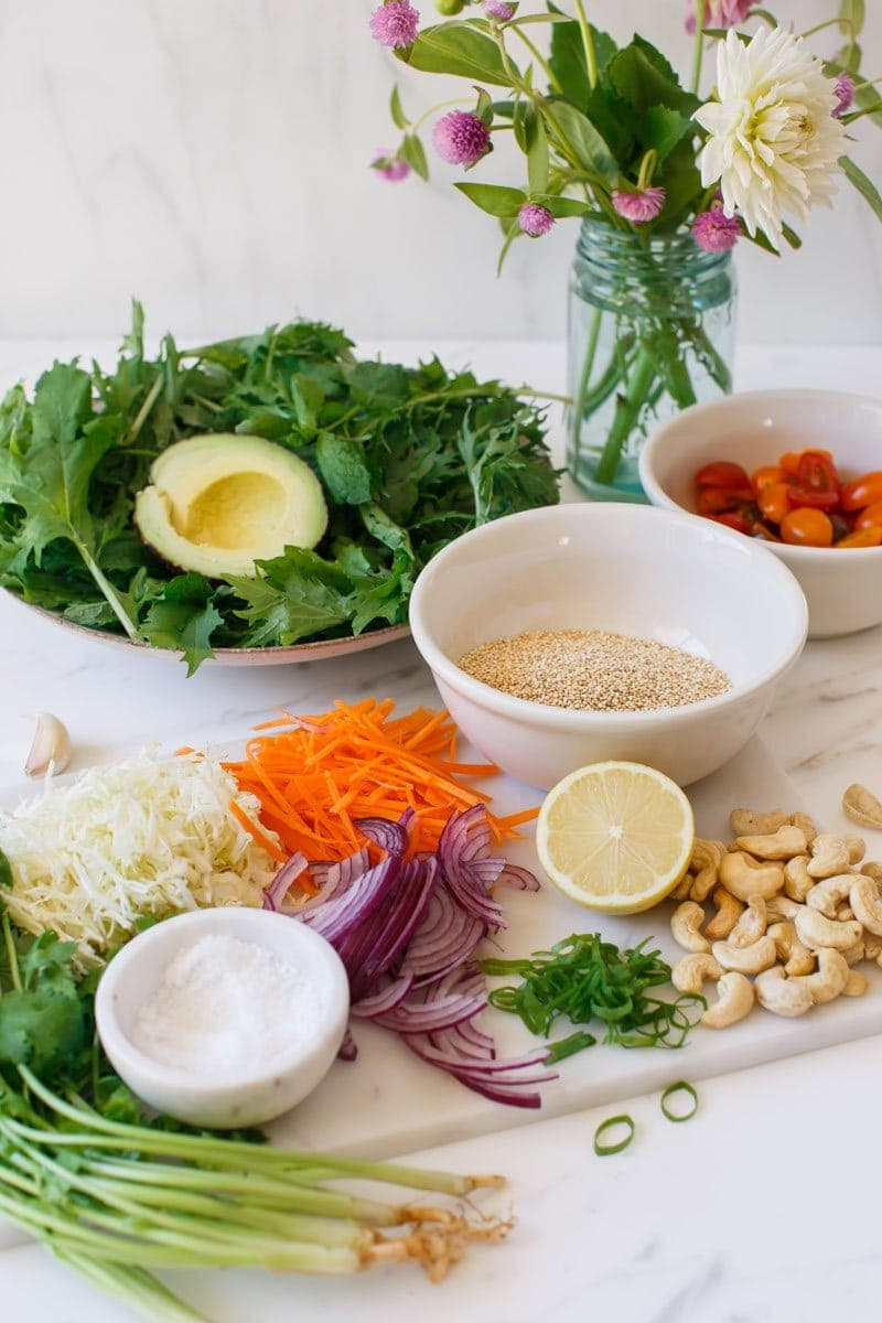 Ingredients laid out for a fresh quinoa salad with avocado