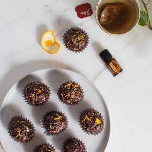 A simple chocolate crackle recipe infused with wild orange essential oil. #chocolatecrackles #chocolatetruffles #essentialoilrecipes #wildorange #doterrarecipes #vegantruffles #easytreats #healthytreats #quickdesserts #healthydesserts #sweetrecipes #sweetideas #AscensionKitchen // Pin to your own inspiration board! //