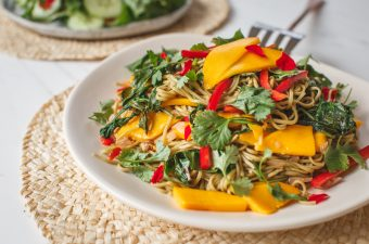 Close up of a colourful soba noodle salad with mango