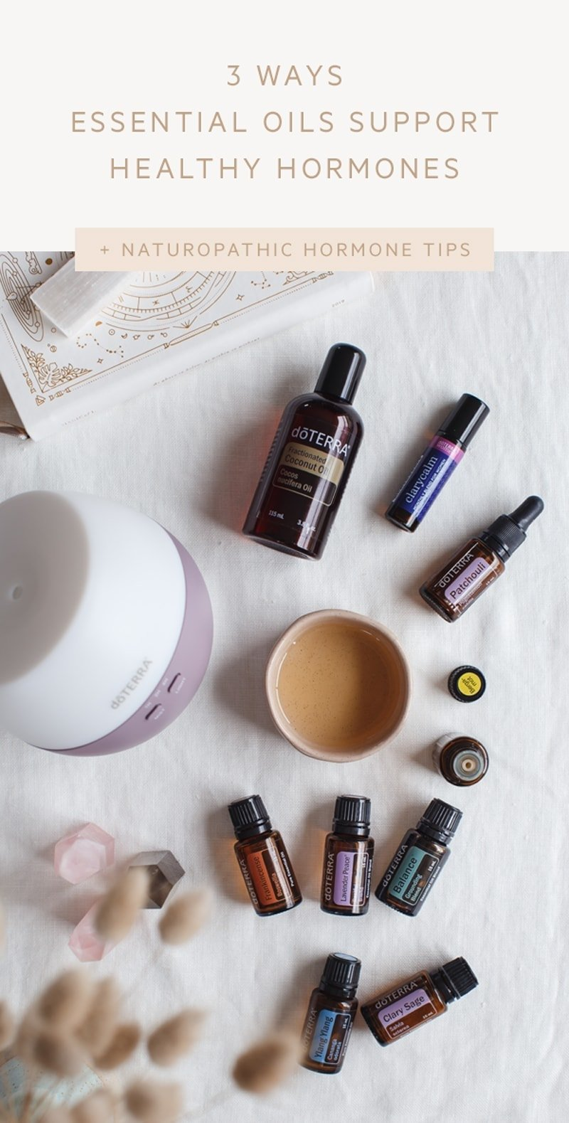 Flat lay of various bottles of essential oils with a diffuser over a linen tablecloth, the blog post title is written over the top.