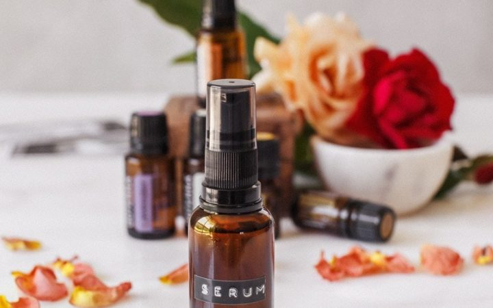 Anti-aging, DIY face serum surrounded by roses