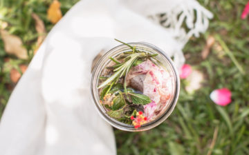 Lunar infusion - a jar of herbs in water outside ready to infuse