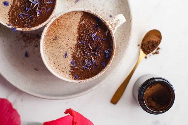 Chaga Mushroom Hot Chocolate in a mug with a dusting of cacao