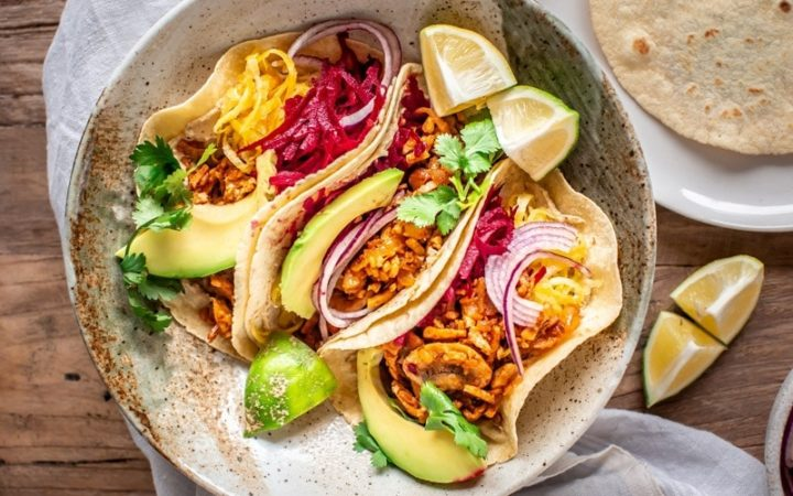 Three vegan tacos jam packed with colourful grated beets, herbs, avo and tempeh meat