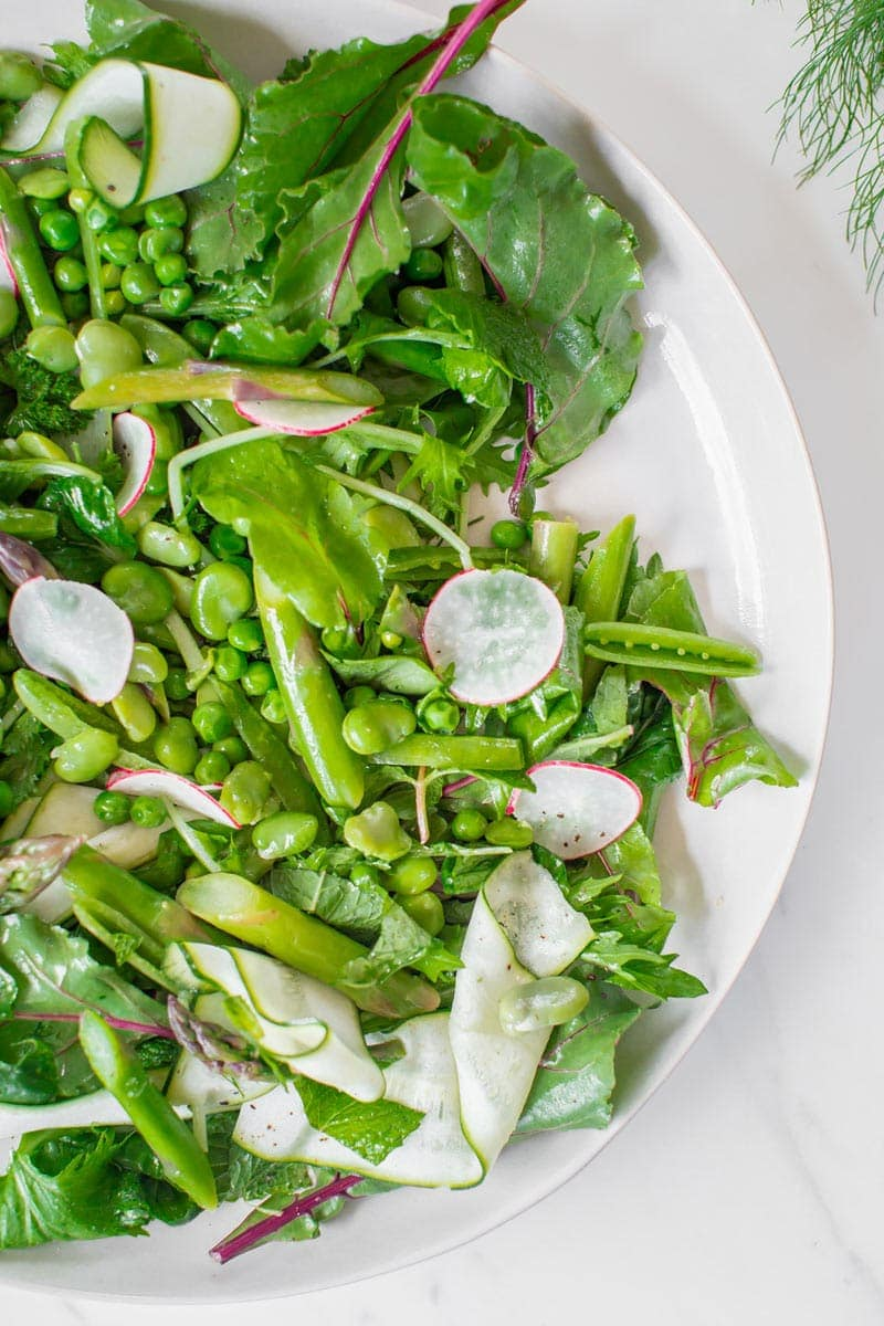 Beautifully styled close up of the asparagus salad showing all the different textures