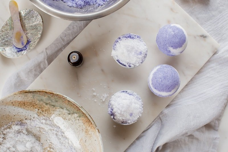Process shot showing multiple bath bombs lined up on a marble tray