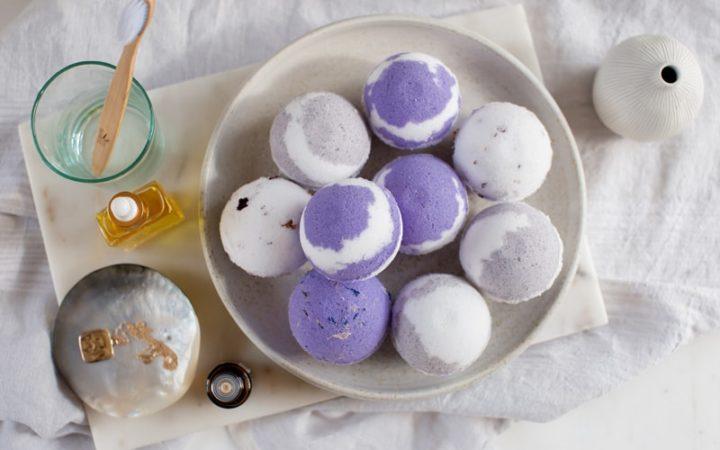 Purple swirl bath bombs on a ceramic plate