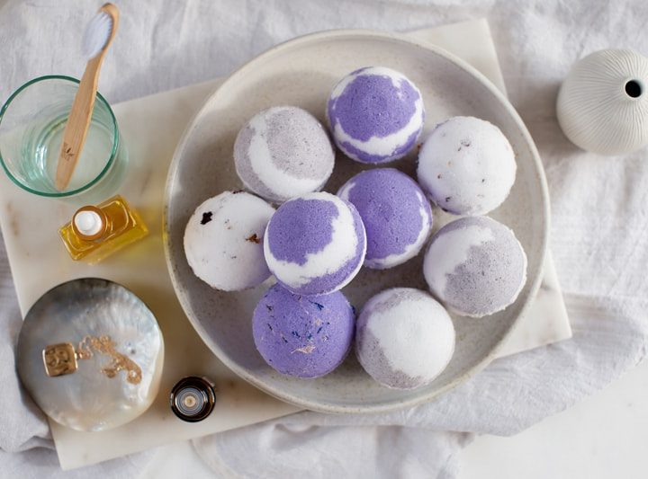 Purple swirl bath bombs on a ceramic plate
