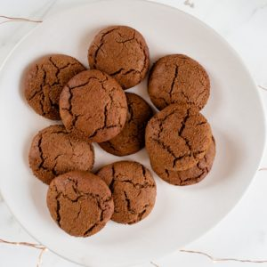 A plate full of delicious golden brown ginger cookies.