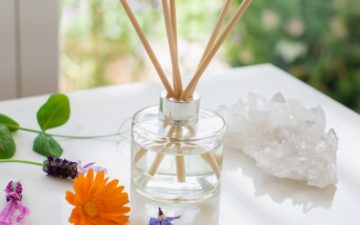 Glass reed diffuser with a stunning silver cap, filled with natural reeds.