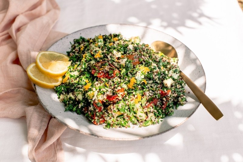 Quinoa Tabbouleh with fresh lemon zest, on an outdoor table