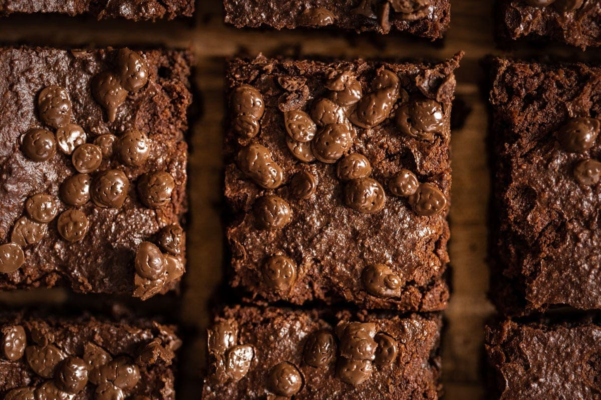 Close up of the brownies showing all the melted, gooey chocolate chips on top