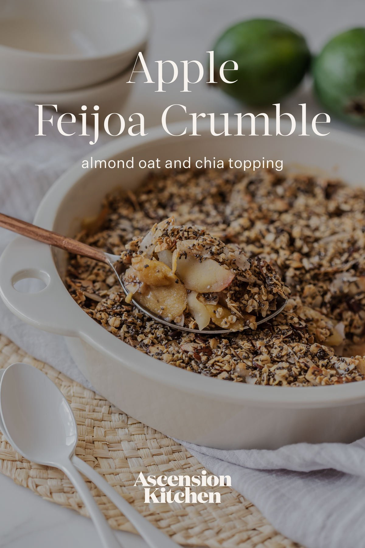 Close up of a serving spoon heaped with soft fruit and toasted crumble topping