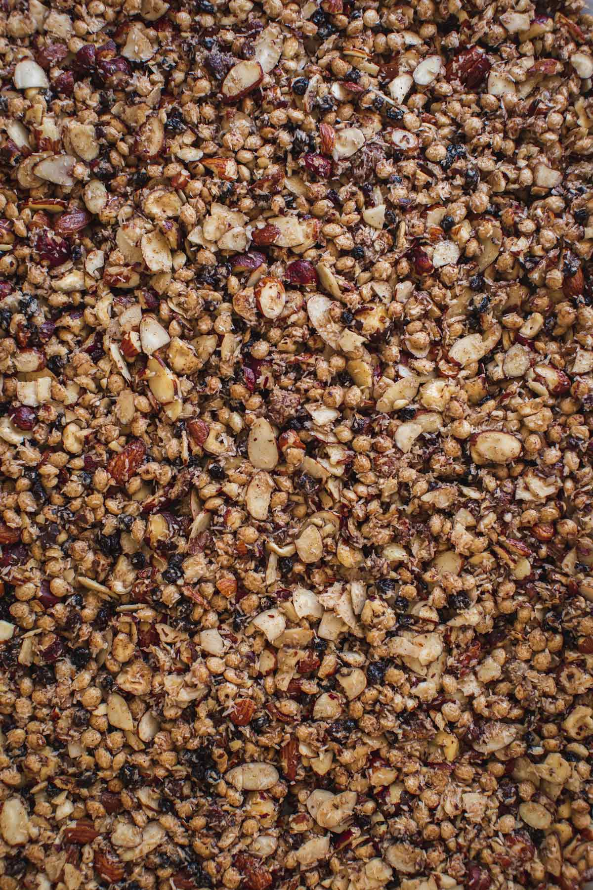 Close up of the baked granola on a baking tray