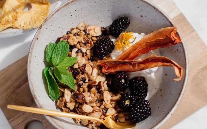 Bowl of hazelnut granola topped with fruit