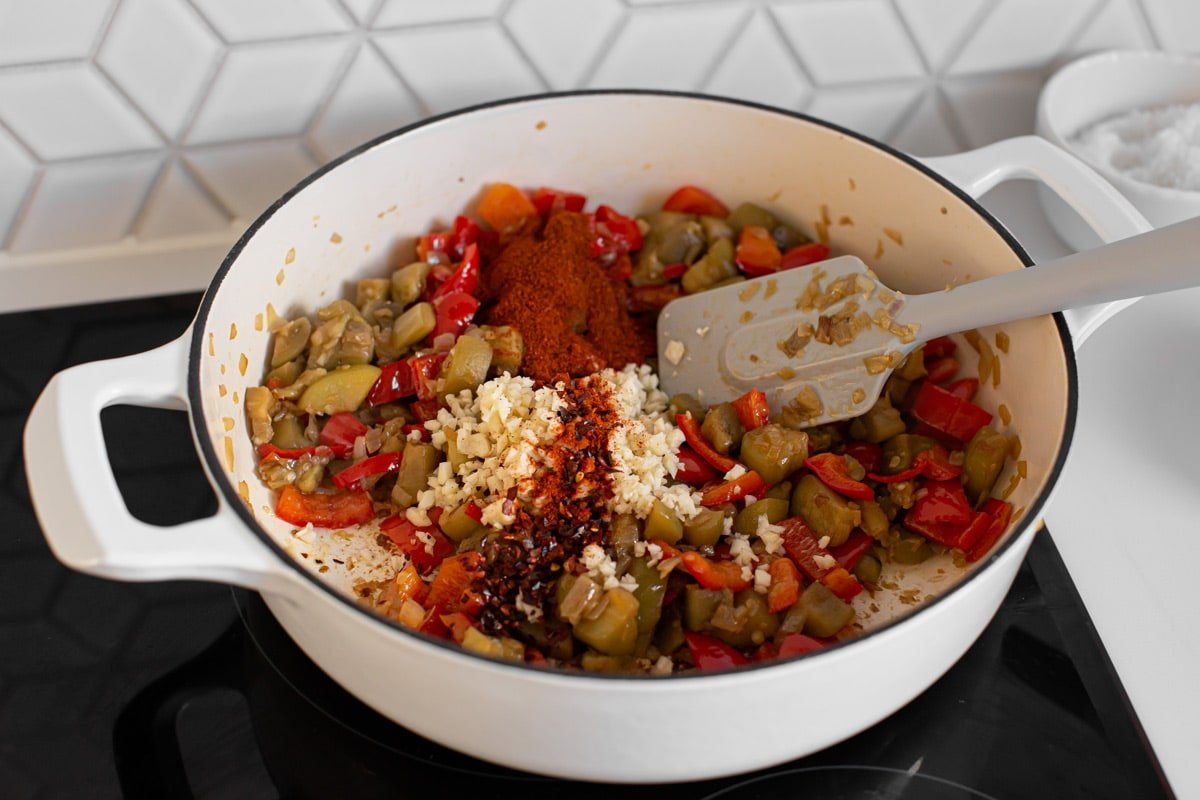 Freshly minced garlic, dried chili flakes and paprika powder added to the vegetables