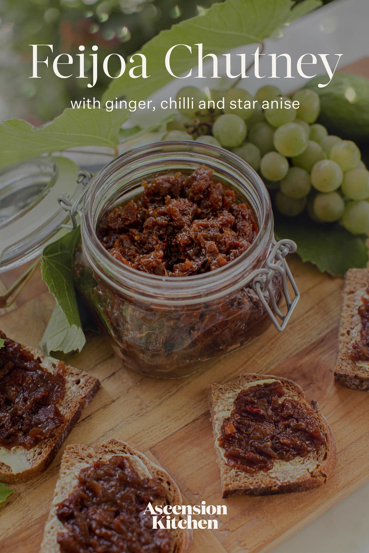 Pinterest graphic for this feijoa chutney recipe - featuring a close up of the chutney in an open jar surrounded by slices of rye and grapes, the recipe title printed over the top
