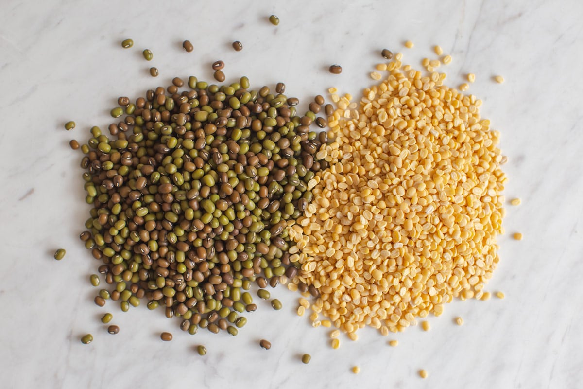 Whole green moong vs split yellow moong dal side by side for comparison.